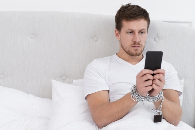 man-checking-his-phone-after-waking-up